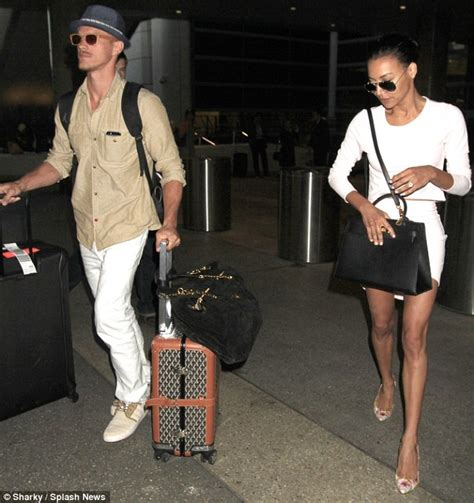 Naya Rivera wears bridal white as she jets home with new